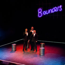 a review of the play bouncers by john godber The play was originally written in the 70s and set in a northern town focusing on the racial and homophobic tensions that were perhaps more prevalent during that time, this modern 'remix' implies they still sadly remain in society today.